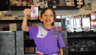 A child holding up a pack of hockey cards for National Hockey Card Day 2019