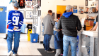 People checking out the CloutsnChara store on National Hockey Card Day 2019