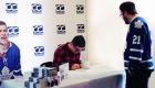 Steve Dangle Glynn signing his book for a fan wearing a Toronto Maple Leafs jersey.