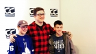 Steve Dangle Glynn posing with two young kids for a photo.