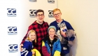 Steve Dangle Glynn posing for a photo with a man and his two young girls.