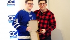 Steve Dangle Glynn and a young male teen posing for a photo while holding a signed pizza box.